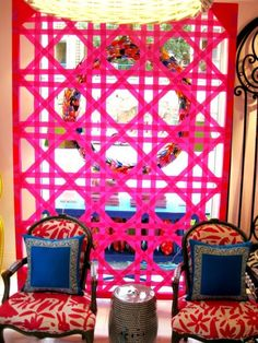 this appears to be a store interior, but Otomi on chairs ooh lala