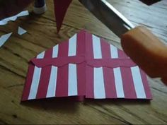 We can have the red paper be already striped to save time. but heres one way to look at it - @Jhanelle Linton  Circus Tent Invitation DIY
