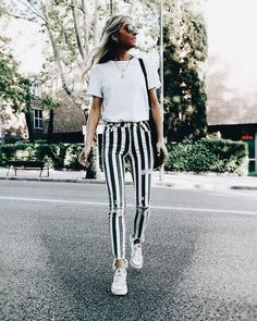 Cute black and white striped pants with white tee.