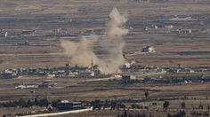 Smoke rises following an explosion in Syria's Quneitra province as Syrian rebels clash with President Bashar Assad's forces, seen from the Israeli-controlled Golan Heights, on August 28, 2014. (photo credit: AP/Ariel Schalit, File)