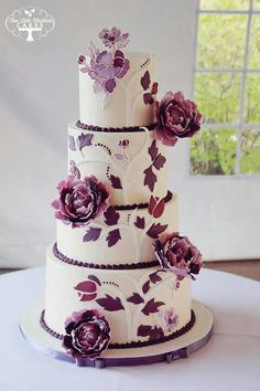 Wedding cake that combines gumpaste flowers with royal icing and fondant decor