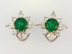 Lwer  Platinum & 18kyg estate earrings with 2 emeralds 3.15ct total, 8 pear shaped dias 1.60ct total, 8 round dias .80ct total  www.factorysinc.com