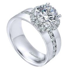 18K White Gold Wide Brushed Channel Set Diamond Engagement Ring. This ring features 1.26cttw of round channel set diamonds set in the middle of a 7mm wide band