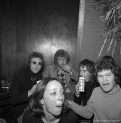 Drinking buddies known as 'The Hollywood Vampires' (L-R -- John Lennon (during his 'Lost Weekend' period), Harry Nilsson, Alice Cooper and Micky Dolenz celebrate an early Thanksgiving watching singer Anne Murray at the Troubadour on November 21, 1973 in Los Angeles, California. (Photo by Richard Creamer/Michael Ochs Archives/Getty Images)