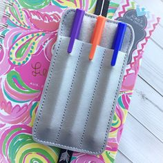 A personal favorite from my Etsy shop https://www.etsy.com/listing/292032941/double-pen-holder-planner-accessories