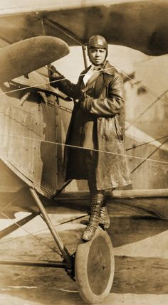 """Bessie """"Queen Bess"""" Coleman, first black female aviator with her biplane - Black History Facts, Black History Month, Aeropostale, Bessie Coleman, Female Pilot, Black Wings, African American History, Native American, Portraits"""