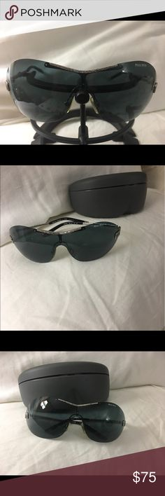 Miu miu Sun glasses Mint condition used miu miu mu62h. Couture miu miu collection metal frame sun glasses. Grey radiant lenses. Frame it's about 7inch long by 2 inch height. There is no major scratches on lenses and metal frame is straight and tight. Miu Miu Accessories Sunglasses