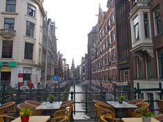 """"""".. guestering across the street to a narrow table inches from the canal."""" (11.162) the restaurant is an elegant, sophisticated place, which is a perfect romantic setting"""