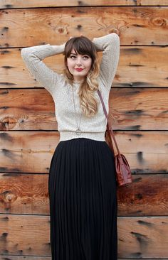 pleated skirt. and neutral sweater.   seems conservative, but very sexy