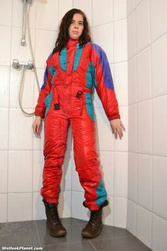 Red shiny ski suit in the shower