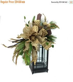 This Burlap Poinsettia Christmas Lantern Swag fits an lantern and is in the colors of natural jute, brown, green and bronze with large Christmas Lanterns, Christmas Crafts, Christmas Urns, Fall Lanterns, Christmas Time, Christmas Ideas, Christmas Tree Trimming, Xmas Tree, Xmas Decorations
