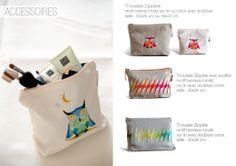 pouches with embroidery made in Rwanda. www.ibabarwanda.com
