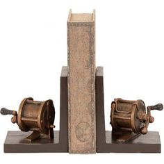 "Set of two reel bookends. Product: Set of 2 bookendsConstruction Material: PolystoneColor: Brown and copperFeatures: Perfect on a bookshelf or fireplace mantelDimensions: 7"" H x 6"" W x 5"" D each"