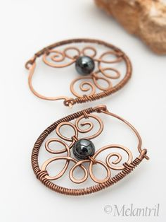"Wirework earrings-( Hammer out horse shoes, punch ""nail holes"" and wire through them. Bead or not this would look nice)"