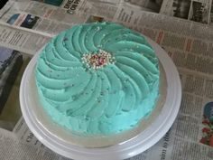 Vanilla sponge cake with butter cream icing  Ani was craving for a simple 2 tier cake with icing. Decided to make this in Rohan ' s favourite colour