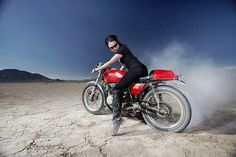 There's something etherial about a woman, on a motorcycle, doing a burnout. So many things together create a vortex of magnificence...that we usually describe as HOT, HOT, HOT!