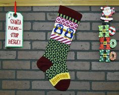 Add a colorful accent to your home with this hand knit Fair Isle, Argyle Christmas stocking! This stocking features adorable Royal Blue Penguins and says Ho Ho Ho in Gold. I hand knit this stocking with a Burgundy cuff, heel and toe. This attractive Christmas stocking makes a great way to welcome Santa to your home each and every Christmas! FREE Personalization!! Your stocking can be personalized on the cuff. Names up to 6 or 7 letters work best (**Longer Names May Wrap Around Stocking**)…