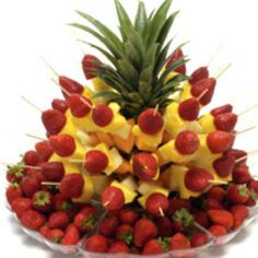 Strawberries and pineapple on a stick!!! I WANT!!