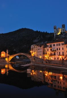 """Dolceacqua, Liguria, Italy -Beautiful Italian medieval town in Liguria part of Italy.  a hillside village with an old castle...this curved bridge was painted by Monet.  Reneé Milburn and I climbed up through the town to the castle and then had lunch at the base...sampled my first """"grappa"""" here.   August 2013"""