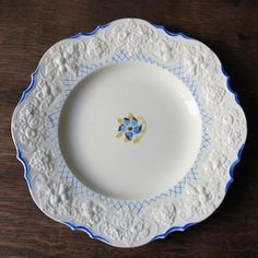 Product Description Crown Ducal pottery plate produced in the as part of their Florentineware range. It is a beautiful plate with a raised decorative border and a simple blue flower in the centre. Spice up your dinnerware with a vintage plate like this! Decorative Borders, Decorative Plates, English China, Pottery Plates, Vintage Plates, Plates And Bowls, Cupboards, Platter, Spice Things Up