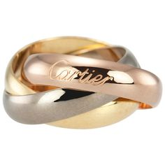 Cartier Trinity Gold Large Model Ring   From a unique collection of vintage band rings at https://www.1stdibs.com/jewelry/rings/band-rings/
