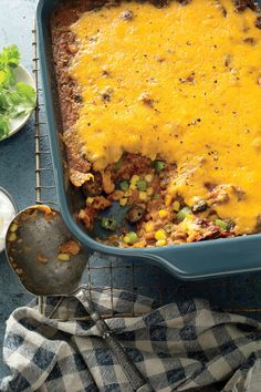 Deb Wise's Tamale Pie Mix-up Recipe | Looking for an easy, one-pan way to feed a crowd? This homey, comforting casserole will fit the bill nicely. Ground beef, cornmeal, tomato sauce, and corn combine with a layer of gooey cheese to make a hearty take on tamale pie, minus the layers. Serve this dish with a big green salad and dinner is done!
