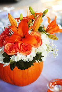 Beautiful fall flower arrangement in a pumpkin