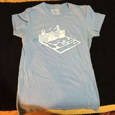 """Paperboy tee-shirt Threadless tee-shirt, Glenn Jones """"paperboy"""" design. The tee is size """"girly small"""" which translates to about an extra-small. Very soft, comfortable, 100% cotton tee. Offers and questions welcome!  Threadless Tops Tees - Short Sleeve"""