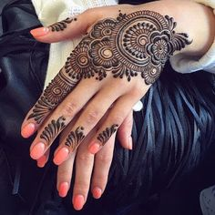 You've got an ocean of henna designs before you, and you can grab your most favorite one. Though it is a small body part, a henna on it looks simple yet elegant. Among all wrist tattoos, henna flower are believed to be the most well-known ones. Henna Hand Designs, Henna Flower Designs, Mehndi Designs Finger, Stylish Mehndi Designs, Mehndi Designs For Fingers, Beautiful Mehndi Design, Best Mehndi Designs, Henna Tattoo Designs, Mehandi Designs Modern