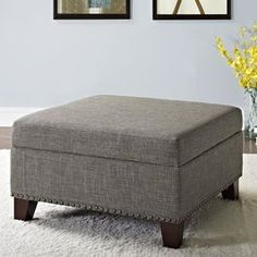 Robertsville Square Ottoman with Nailheads is the perfect combination of style and practicality. The Robertsville Ottoman features an individually-set antique metal nailhead trim, beautiful linen-look fabric, and a nicely padded ottoman top, perfect for propping up tired feet. Use its flat surface with a tray and the Robertsville Square Ottoman with Nailheads doubles as a coffee table. But the best kept secret is it's easy-to-lift hinged top, allowing you to store away magazines, DVDs, to...