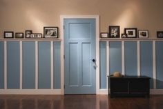 Craftsman look for interior doors- down the hallway in the basement... don't like the two toned color, but do like the wainscotting down the hall.