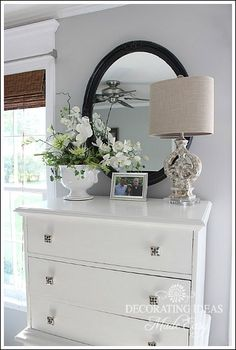Again, great styling on a newly painted dresser lightens up the look
