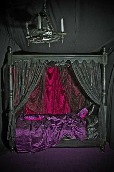 Gothic bedroom. LOVE the bed frame, coverings, and purple sheets. would do something different with the walls though.