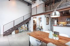 This historical designer loft with an industrial  LA-Arts District aesthetic offers a unique feel for offsite, special event, film or production need. The sunny space has a blend of industrial light fixtures, rustic finishes, concrete floors reclaimed wood table and sheepskin throws for a modern artistic environment.