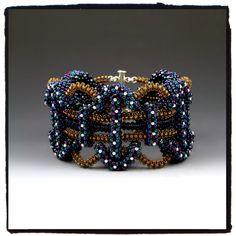 "Atlas Bracelet by Rachel Nelson-Smith • glass, crystal, silver, nylon • 4"" x 2.5"" x 4"""