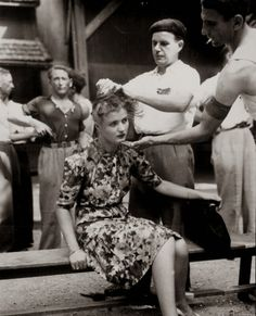 "A ""femme tondue"" (shorn women). Montelimer, France. August 29, 1944."