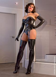 yourkinkymistress:  Need to be dominated?  She wears her rubber and corset very well -
