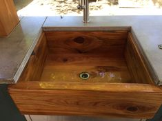 This is a handmade cypress sink coated with waterproof epoxy. Looks great in outdoor kitchen and is plenty big to hold all those pans after a barbecue Farmhouse Sink Kitchen, Farm Sink, Diy Kitchen Cabinets, Wooden Kitchen, Kitchen Sink, Kitchen Appliances, Farmhouse Style, Rustic Farmhouse, Kitchen Dining