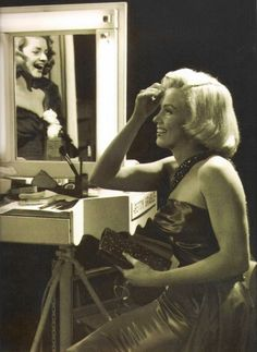 I love this photo and how through the mirror you can see Lauren Bacall sharing a laugh with Marilyn!