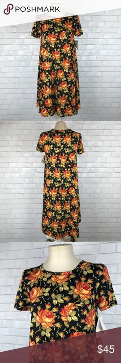 """LuLaRoe Carly Dress in Black Rose Print New with tags LuLaRoe Carly Dress in Black Rose Print. Size Small. Black background with Rose print. 95% polyester, 5% spandex. Made in Vietnam. Chest pocket. High low hemline. Bust 38"""", length at front 39"""", length at back 45"""". Short sleeves. No trades, offers welcome. LuLaRoe Dresses High Low"""