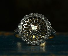 Vintage 1900's Edwardian cognac sunflower diamond engagement ring..takes my breath away..............