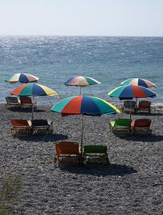 beach umbrellas - photo/picture definition - beach umbrellas word and phrase image