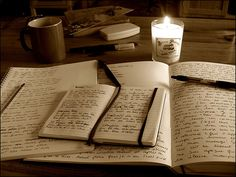 ideas, thoughts, memories on paper by candle light