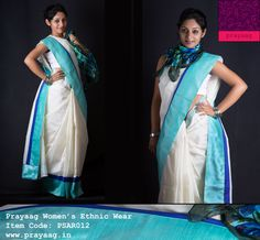 Off-white cotton saree with cyan and blue borders