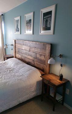 Master bedroom make-over. Pallet headboard, king platform bed, IKEA wall lamps and nightstands, Paris prints!