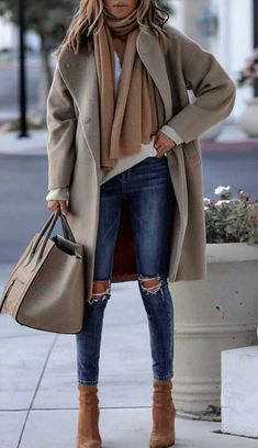 #winter #outfits blue jeans; brown boots; brown scarf