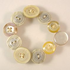 Beige Mismatched Button Bracelet by XOHandworks $10