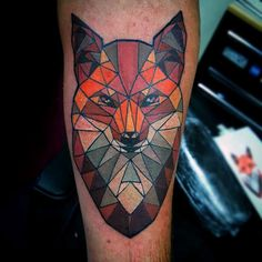 Colored Geometric Fox Tattoo different placement for me..
