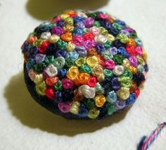 French knot button-love this, wouldn't this be nice as a feature button on a jacket or coat