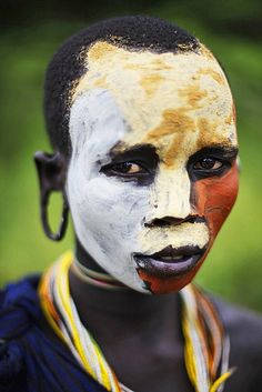 Africa | Young Surma/Suri woman. Ethiopia | © Makis Siderakis    Beautiful facepaint.  Reminds me of a modern art painting.